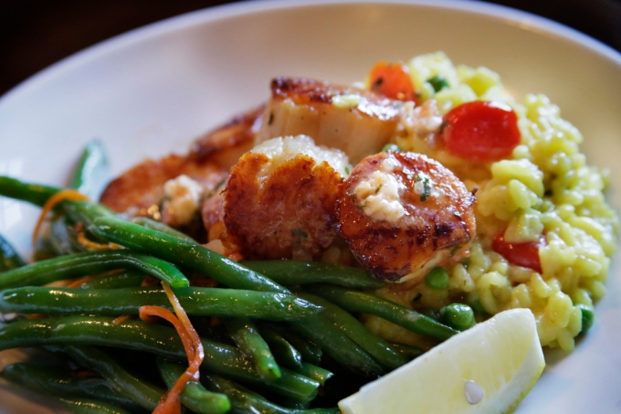 The Seared Scallops with tomato butter and saffron green pea risotto at the Charlestown Rathskeller  Jill Connor / The Westerly Sun